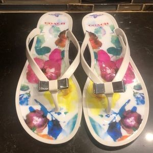 Coach white Landon silver bow jelly flip flops